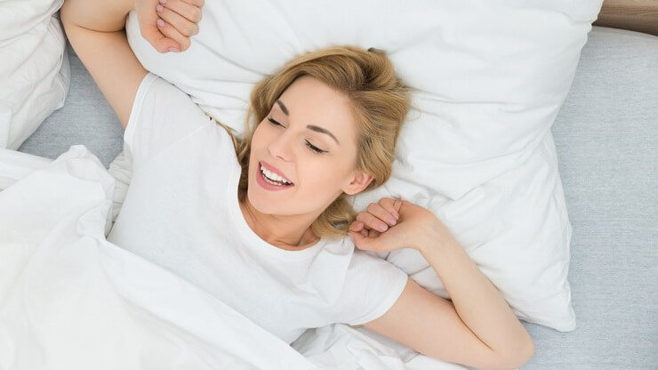 bigstock Woman Stretching Arms In Bed 98054651
