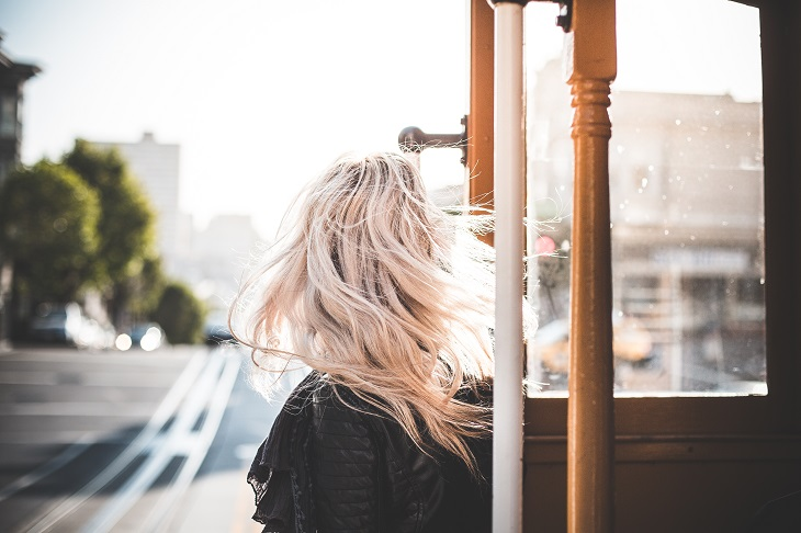 young woman enjoying ride on an iconic cable car in san francisco 2 picjumbo com